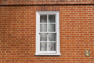 a window surrounded by brick