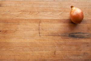 onion sits on butcher-block tabletop