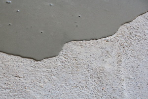 self leveling compound wet on concrete