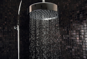 modern silver shower head dispensing water