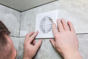 Installing an exhaust fan in a tile shower
