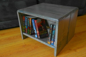 A footstool with a built-in bookshelf.
