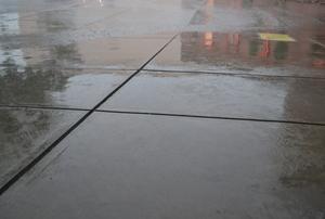wet concrete driveway