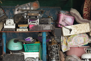 Stacks of junk stored in a garage.