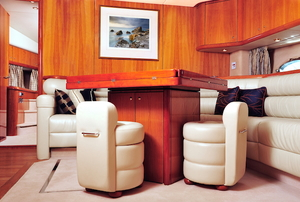 luxury room in a boat with carpeting and furniture