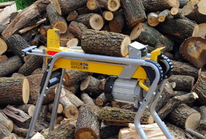 a log splitter in front of a pile of wood