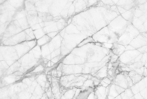 A white marbled surface used for flooring or countertops.