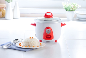 A white and orange rice cooker.