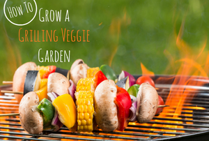 A BBQ with a flame and vegetable kabobs.