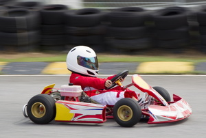 Person driving a go kart