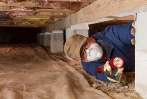 A man in a crawlspace.