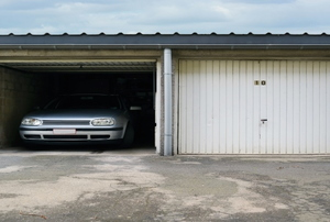 car in a garage with a flat roof