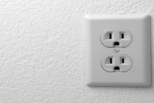 An outlet on a wall.