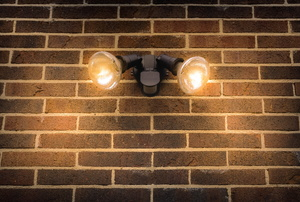 Flood lights mounted to a brick wall