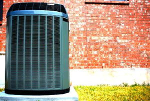 A high-efficiency, modern AC unit in front of a brick wall.
