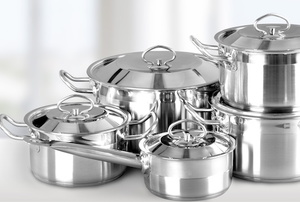 aluminum pots and pans on kitchen countertop