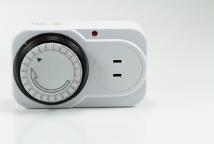 One example of a timer switch for lights, sitting on its side.