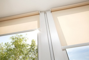 partially open roman shades on windows