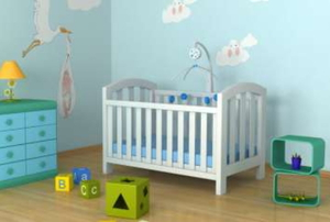 A white baby crib sits in a room with blue walls and a hardwood floor.