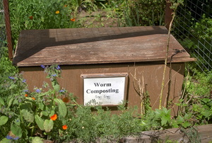 A bin that says worm composting.