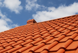 A home roof covered in clay tiles.