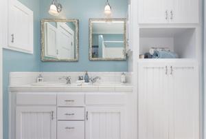 Two bathroom mirrors.