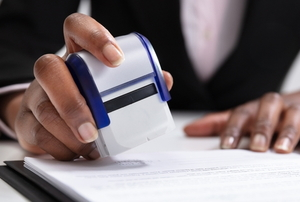 permit expediter stamping a document