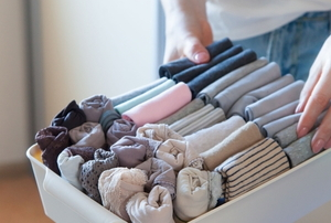 neatly folded clothes in a small drawer