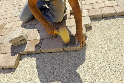 How to Add Pavers along the Sides of a Concrete Driveway