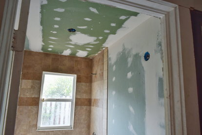 A Bathroom Construction Zone With Greenboard.