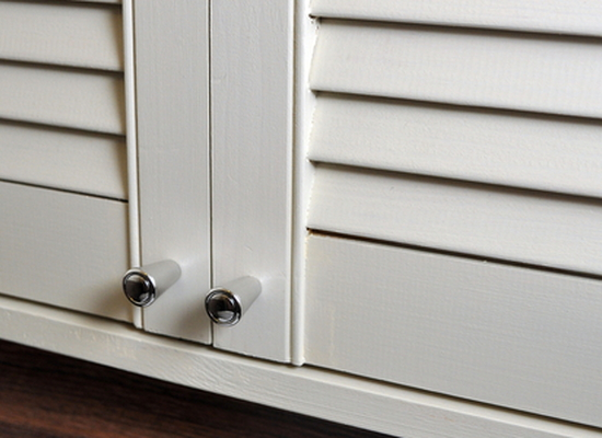 white painted louvered (slatted) closet doors