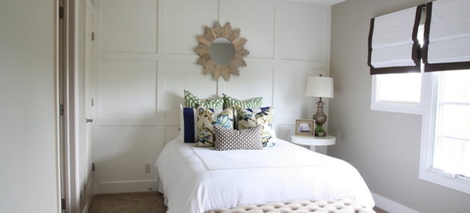 bedroom with board and batten wainscoting