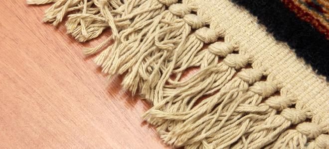 A rug with fringe.