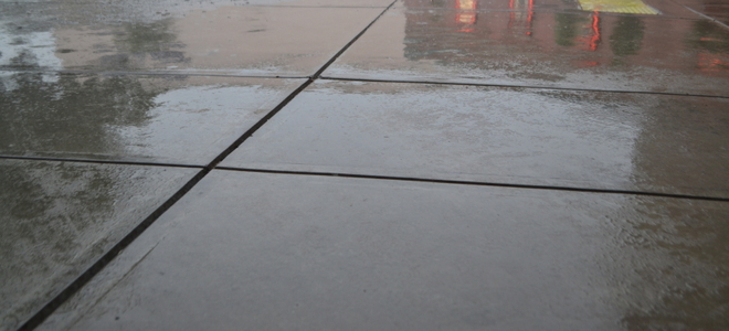 How To Seal A Concrete Driveway Doityourself Com