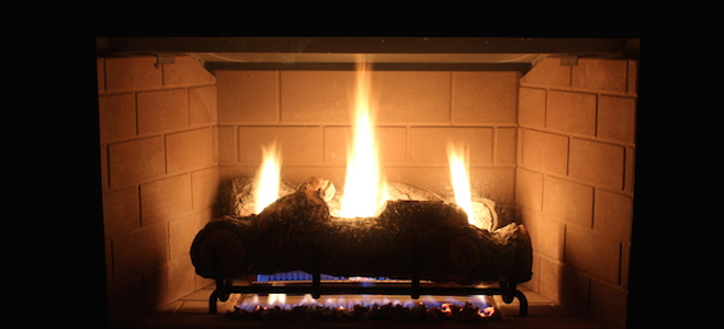 Turn your wood fireplace into one that uses natural gas by adding a fireplace gas line.