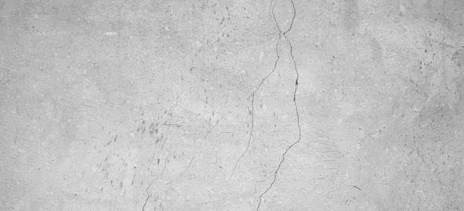 Cracks in a cement floor.