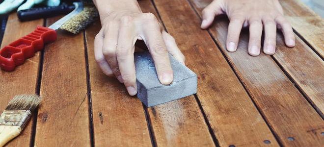 Sanding wood.