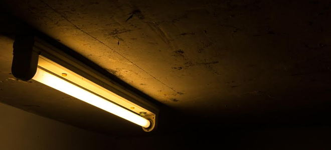 Fluorescent lighting in a dark room.