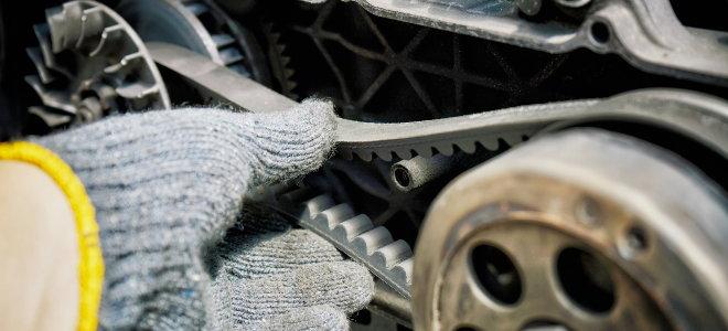 gloved hand test engine transfer belt
