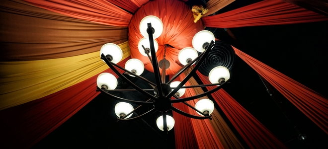 chandelier with hanging fabric and bright candles