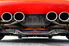 back of a red car with four exhaust pipes