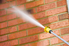 pressure washing a brick wall