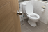 A toilet in a bathroom.