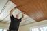 Man installing plank ceiling