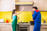 man and woman pointing and discussing a range hood