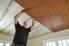 man installing ceiling planks