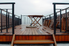 a redwood deck with black railings