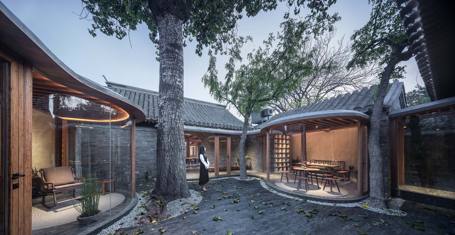 Billowing Glass Rooms Enlarge a Traditional Beijing Courtyard House
