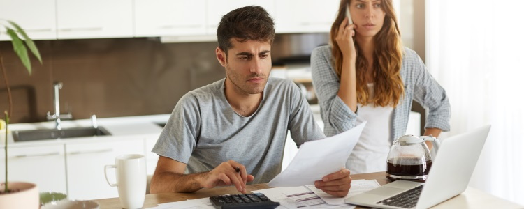 couple calculating their budget, budgeting