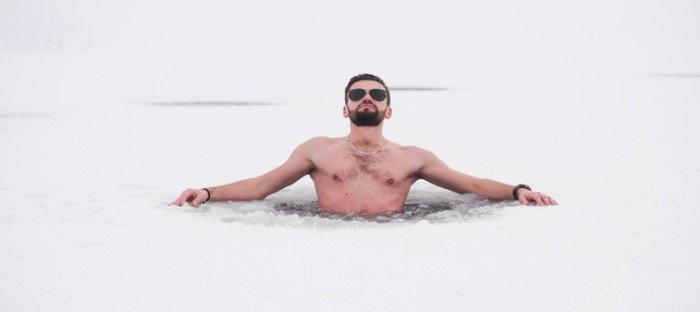 man enjoying a soak in a pool
